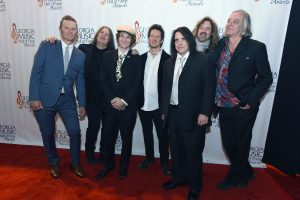 September 26, 2015 Atlanta - Group Award inductee Drivin N Cryin poses with award presenter Peter Buck (right) with R.E.M. for photographers on the red carpet before the start of the 37th Annual Georgia Music Hall of Fame Awards at the Georgia World Congress Center on Saturday, September 26, 2015. HYOSUB SHIN / HSHIN@AJC.COM